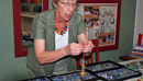 Glass Artist Mimi Vellek displaying some of her work during the Artwalk