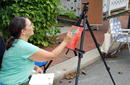 Artist Michele Frantz creating a painting during the Artwalk