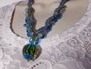 "Pam Troutman's ""Spring Greens"", Bead Woven Necklace with fringe over a lampwork glass focal"